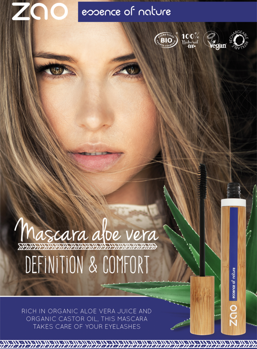 poster image of womans face in natural setting amongst aloe vera, zao aloe vera mascara in bamboo tube displayed in image