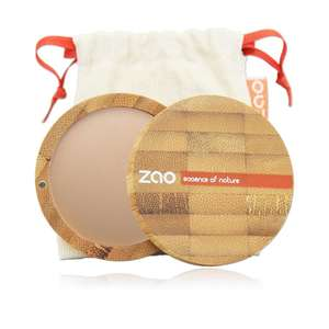 Bronzing powder shown in open bamboo compact with natural cotton pouch behind, label shows Zao
