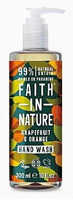 A clear pump dispenser bottle with decorative orange and grapefruit labelling with green leaves. label shows faith in nature grapefruit and orange hand wash.