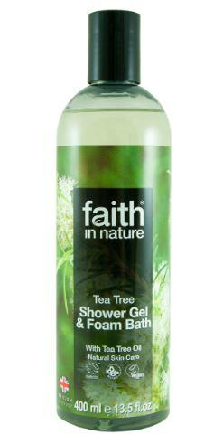 A clear bottle with black cap. Photo image label showing tea tree plant. Label shows faith in nature tea tree shower gel.