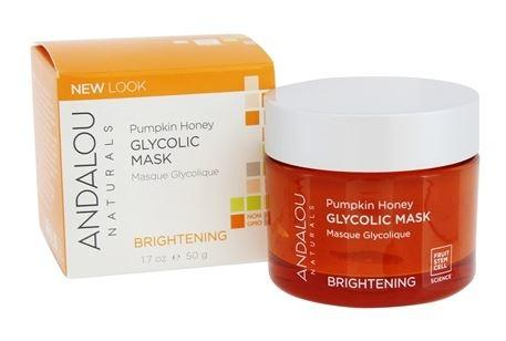 An orange jar with silver lid. Label shows andalou pumpkin and honey glycolic mask. white and orange box packaging.