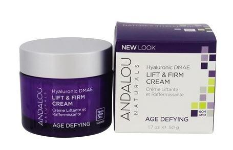 a purple jar with silver cap. Label shows andalou hylauronic dmae lifting and firming cream. white and purple box packaging.