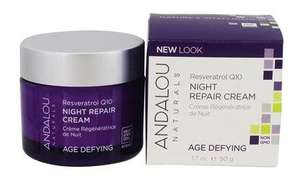 a purple jar with silver lid. Label shows andalou resveratrol night repair cream. White and purple box packaging.