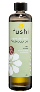 A brown glass bottle with black lid. Natural label shows fushi calendla triple infused oil.