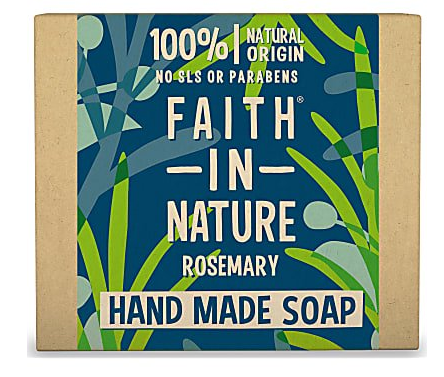A natural brown rectangle soap box with illustrated decorations of green and blue leaves on a blue background. Text shows faith in nature rosemary hand made soap.