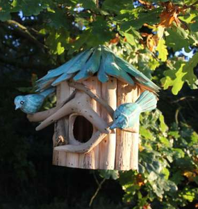 hanging birdhouse made from driftwood. Blue driftwood roof, natural driftwood box, two wooden perches with blue carved birds.