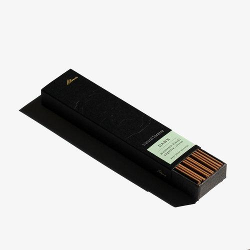 A partially open black rectangular box showing brown incense sticks inside.