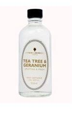 clear glass bottle showing tea tree and geranium reed refill