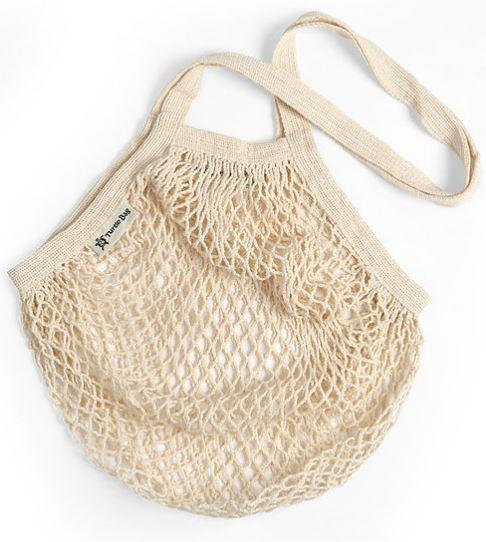 empty long handled natural cotton string shopping bag