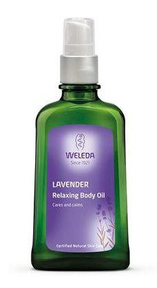 a green bottle with white cap. Purple label shows weleda lavender relaxing body oil.