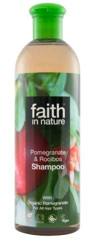 A clear plastic bottle with green cap. Label has photo image of red pomegranate fruit tree. Label shows faith in nature pomegranate and rooibos shampoo