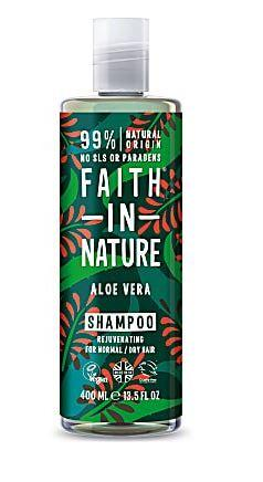 A clear bottle and cap, decorated label with graphic images of red aloe vera flowers and green leaves. Label shows faith in nature aloe vera shampoo