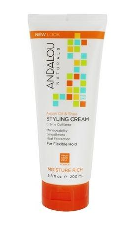 A white plastic squeezy tube with orange cap. Label shows andalou argan oil styling cream.