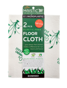 A white cloth with printed image of green plants. Packaged in a green card wrap showing maistic microplastic free floor cloths.