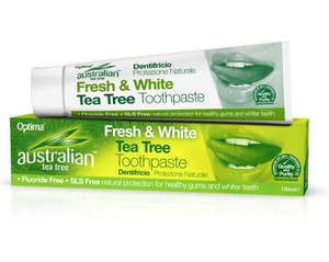 A white toothpaste tube with green text on top of green box packaging. Labelling shows Austrailian Tea Tree Toothpaste