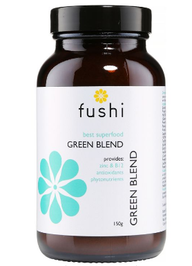 A brown glass jar with black lid. White label shows Fushi best superfood green blend.