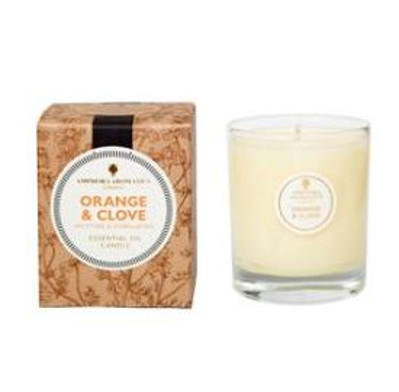 ivory candle in clear glass pot with natural brown box labelled orange and clove