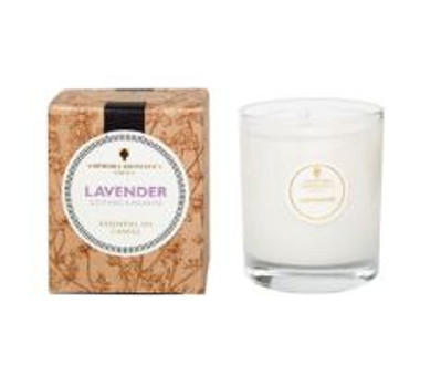 ivory candle in clear glass pot with natural brown box labelled amphora lavender