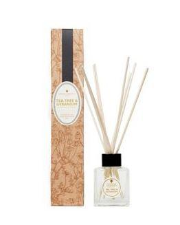natural brown decorated box and clear glass bottle labelled amphora tea tree and geranium reed diffuser