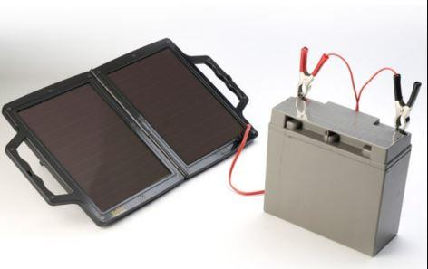portable solar charger connected to battery