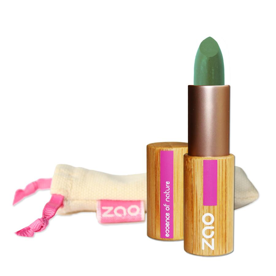 open green concealer stick in a bamboo case, natural cotton pouch shown behind, label shows Zao