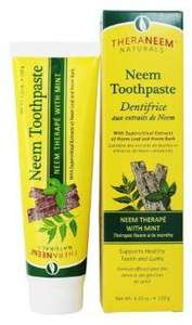 yellow box with green labelling showing Neem toothpaste, stood next to a yellow plastic tube with green labelling showing Neem Toothpaste with mint