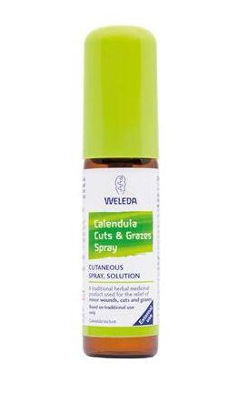 a brown spray atomiser bottle with a green cap. White and green label shows weleda calendula cuts and grazes spray.