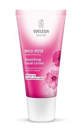 A dark pink squeezy tube with white cap. Label shows weleda wild rose smoothing facial lotion.