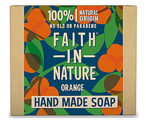 A natural brown card box with illustrated label of green leaves and orange flower blossom. Label shows faith in nature orange soap.