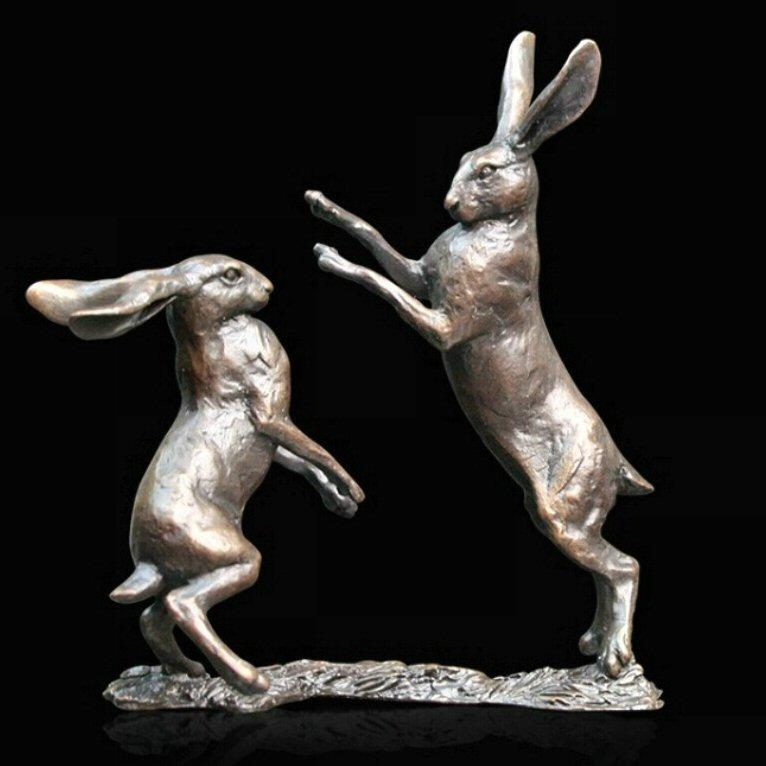 Small Hares Boxing (830) in bronze by Michael Simpson