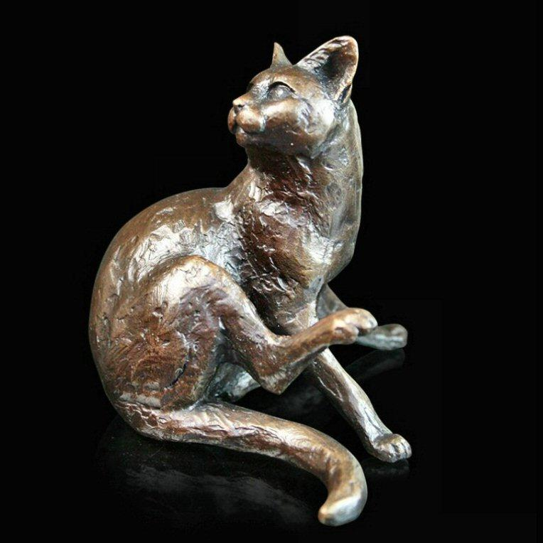 Cat Sitting (745) in bronze by Michael Simpson