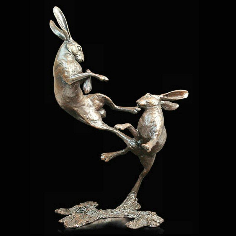Medium Hares Boxing (831) in bronze by Michael Simpson