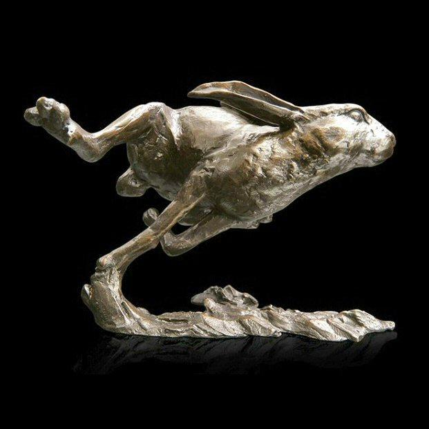 Medium Hare Running   (939) in bronze by Michael Simpson
