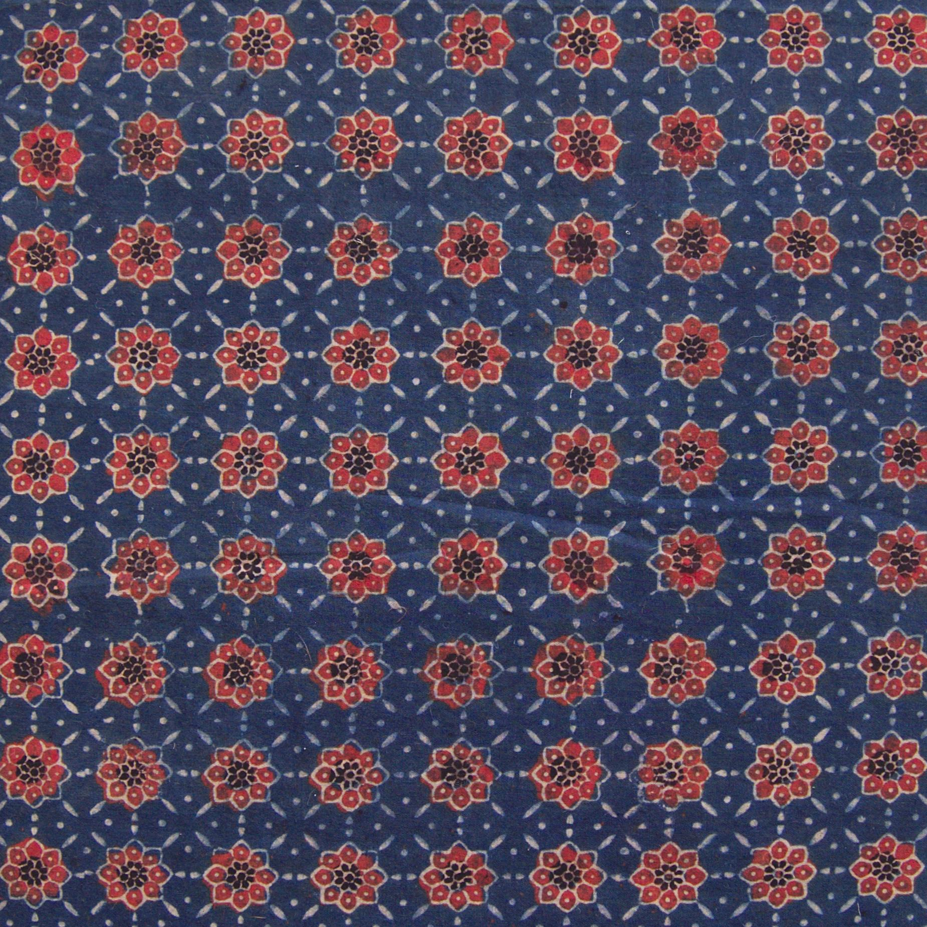 Block Printed Fabric, Cotton, Ajrak Design: Indigo Blue Base, Madder Red Flower. Close Up