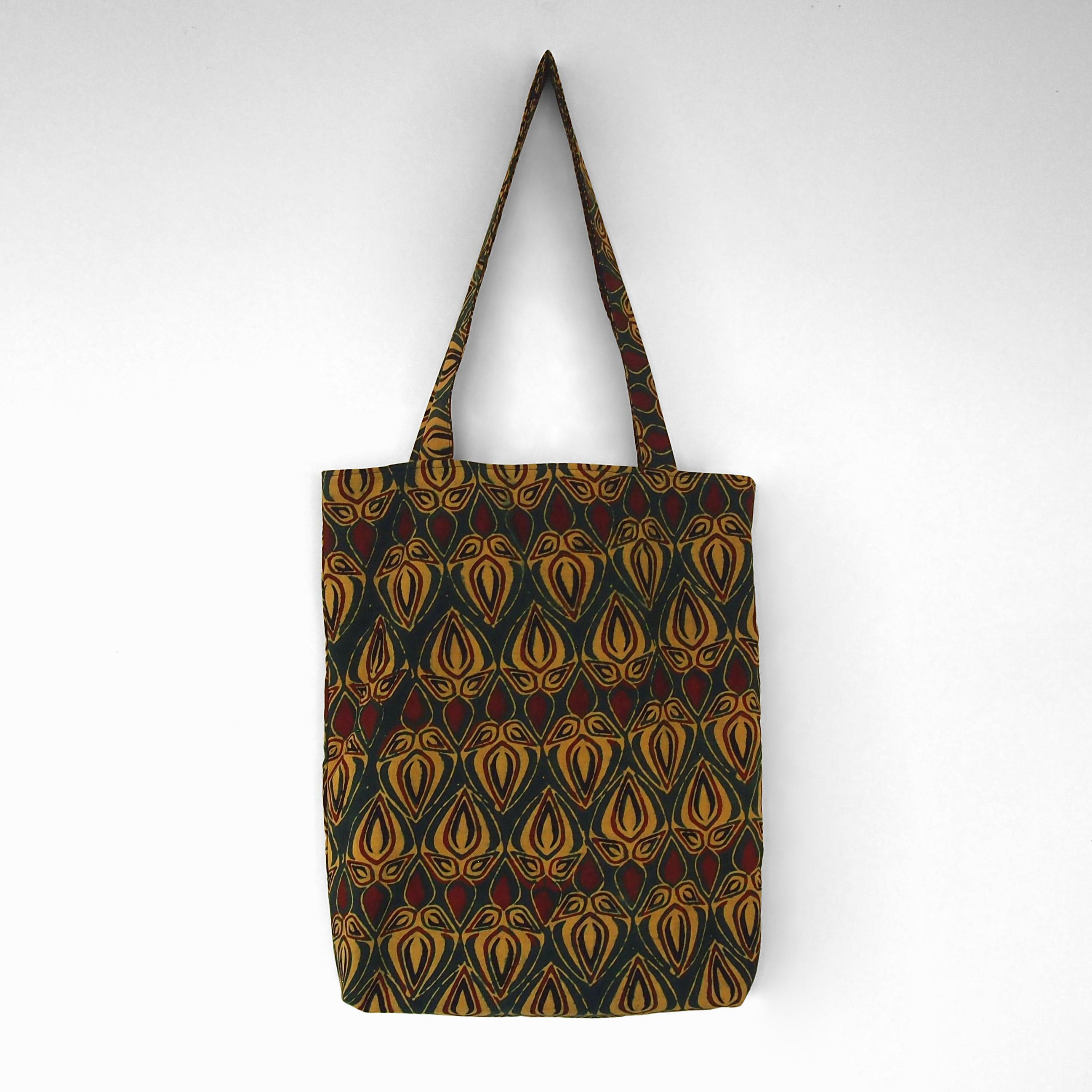 block printed cotton tote bag, green, yellow red bud, natural dye, lined with black cotton, closed