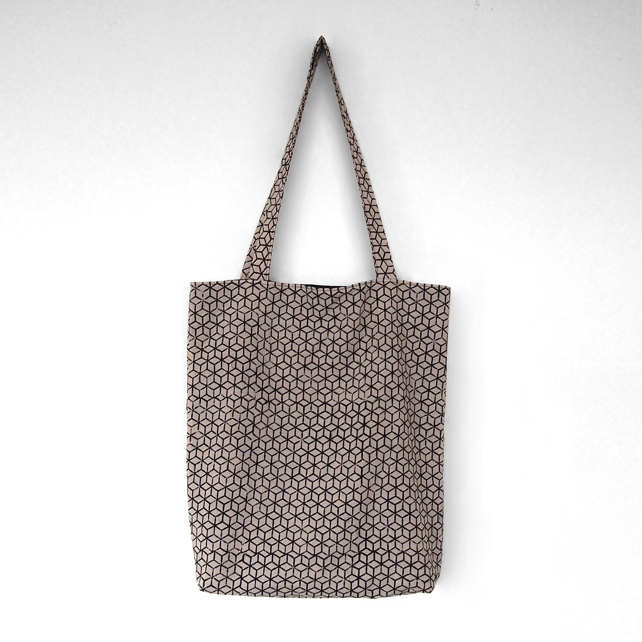 block printed cotton tote bag, natural dye, beige, black tumbling block, lined with black cotton, closed