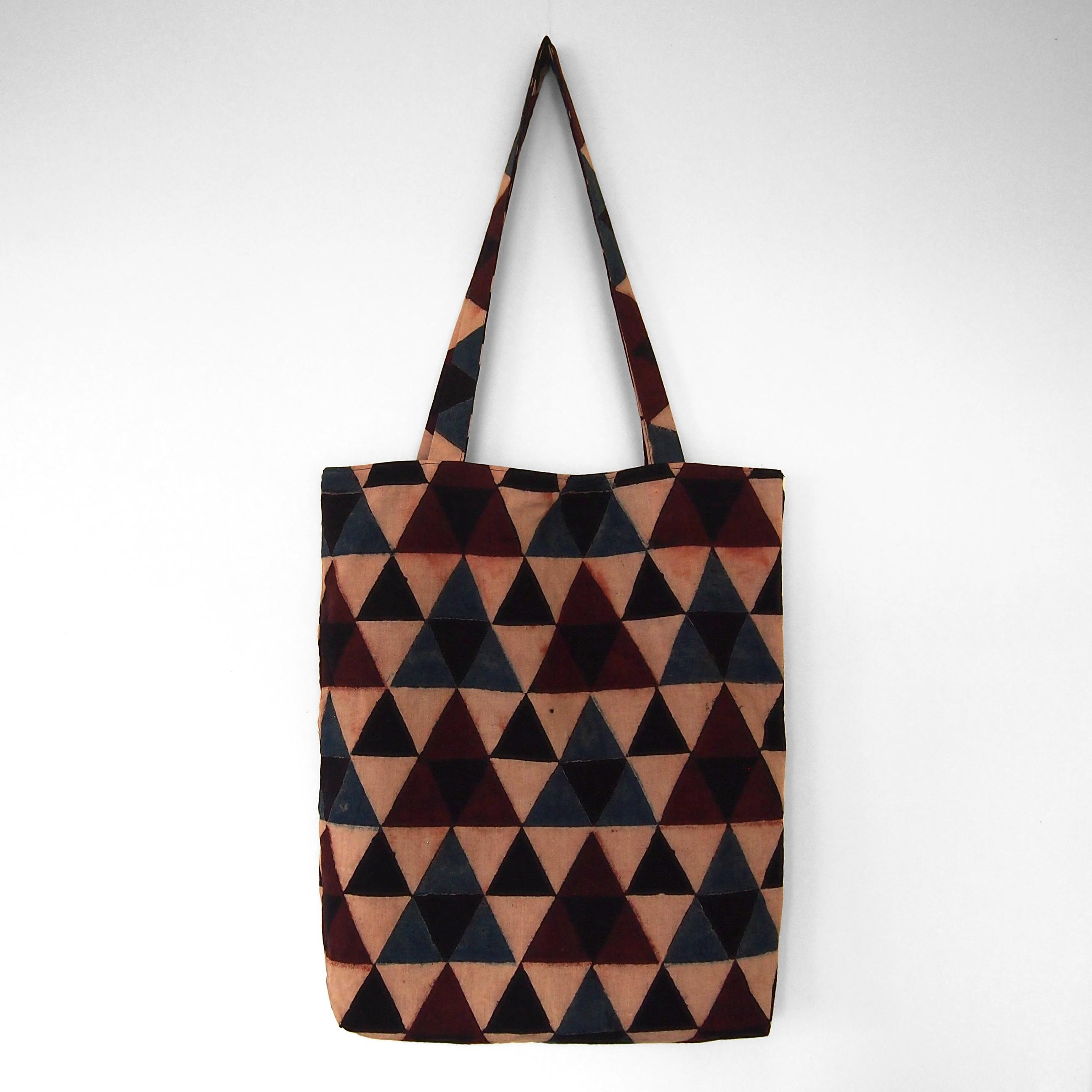 block printed tote bag, cream, black blue red triangle design, lined with black cotton, closed