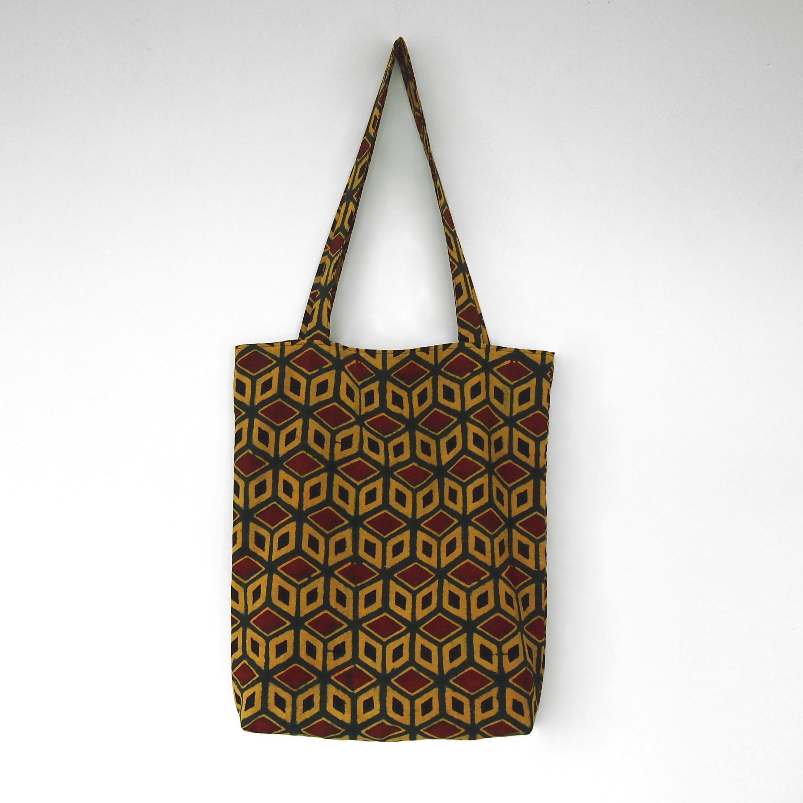 block printed cotton tote bag, yellow, green red black tumbling block design, natural dye, lined with black cotton, closed