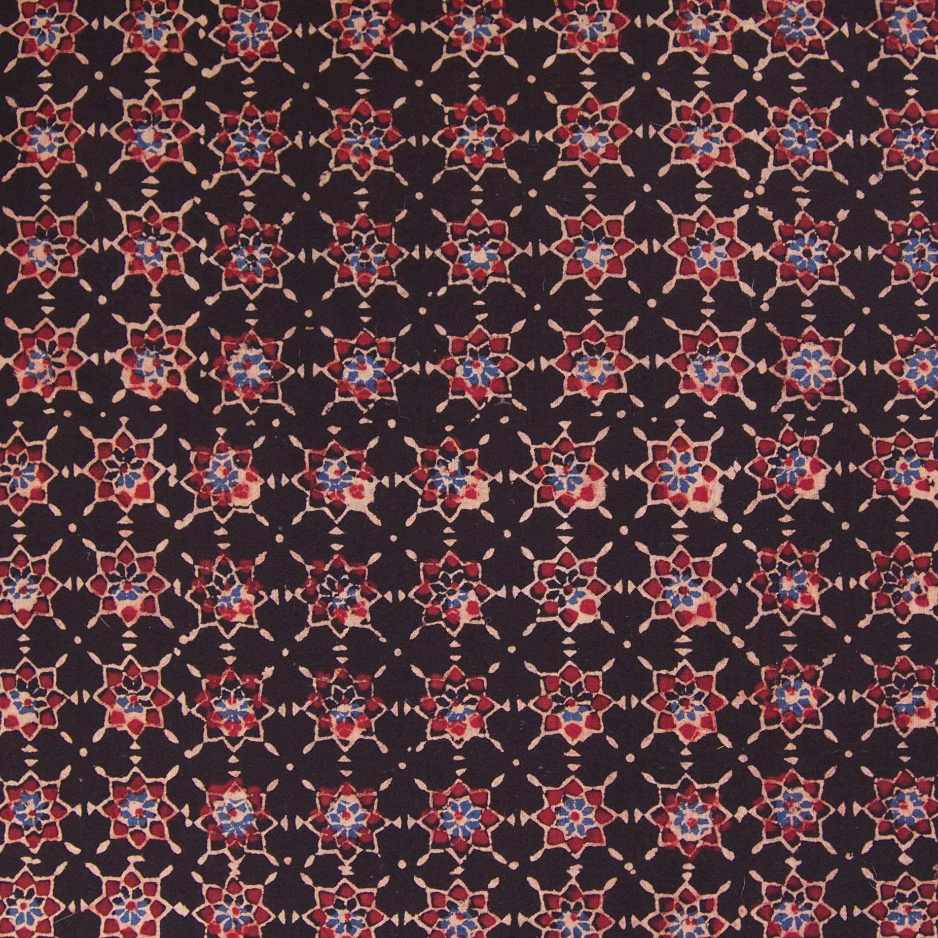 Block Printed Fabric, 100% Cotton, Ajrak Design: Iron Black Base, Red, Blue Starburst. Close Up