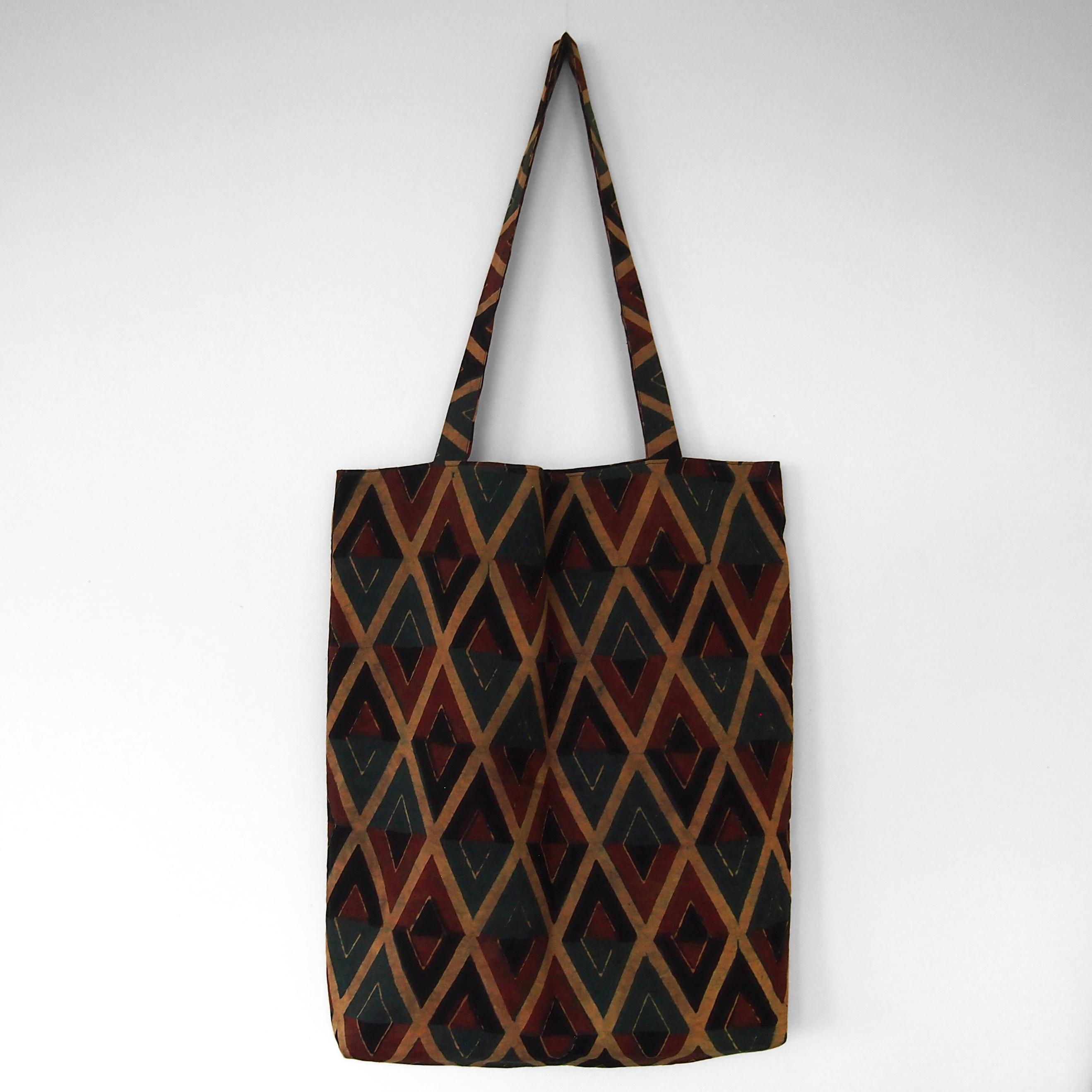 block printed cotton tote bag, natural dye, yellow, red green black diamond design, lined with black cotton, closed