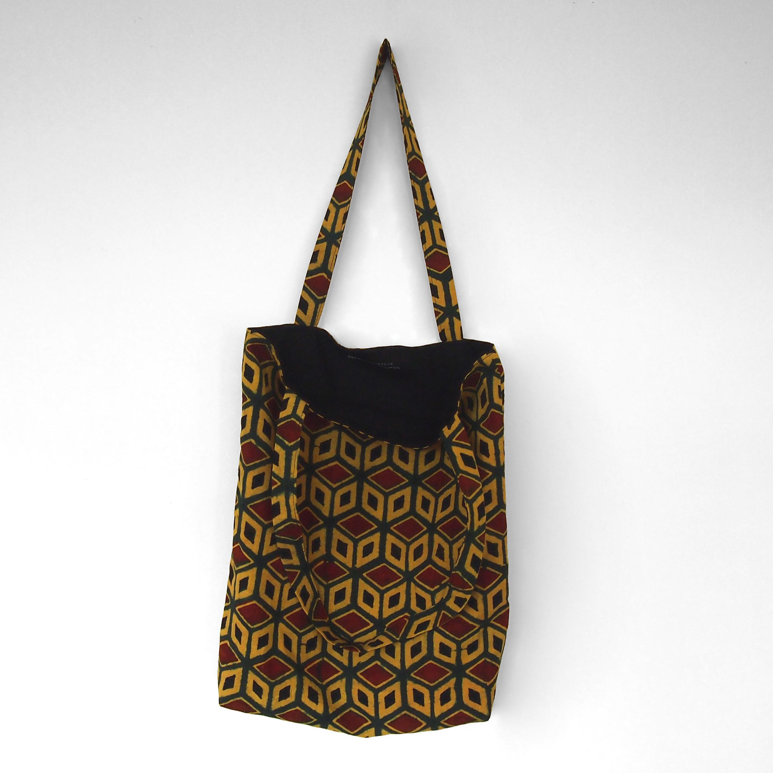 block printed cotton tote bag, yellow, green red black tumbling block design, natural dye, lined with black cotton, open