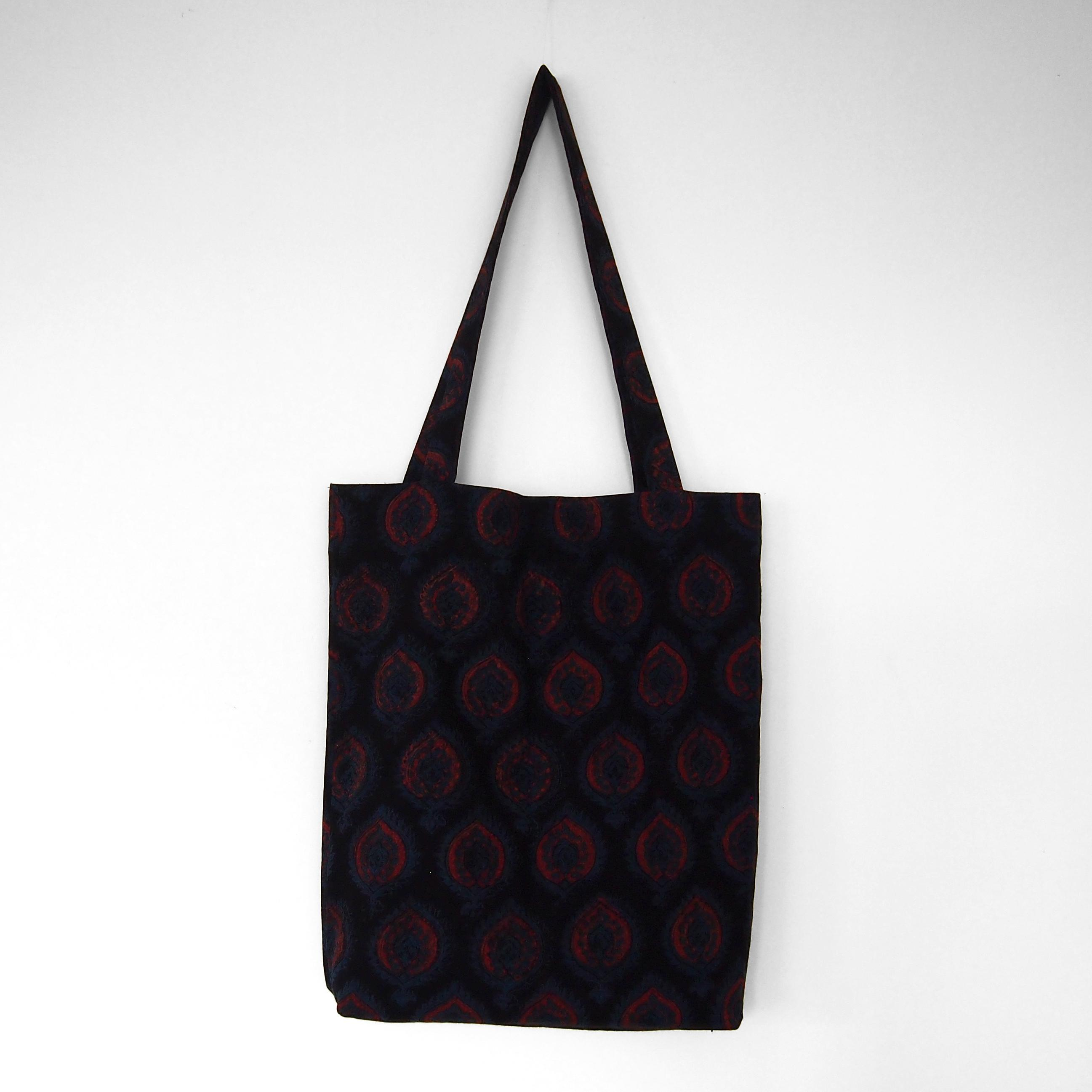 block printed cotton tote bag, natural dye, black, blue red crest design, lined with black cotton, closed