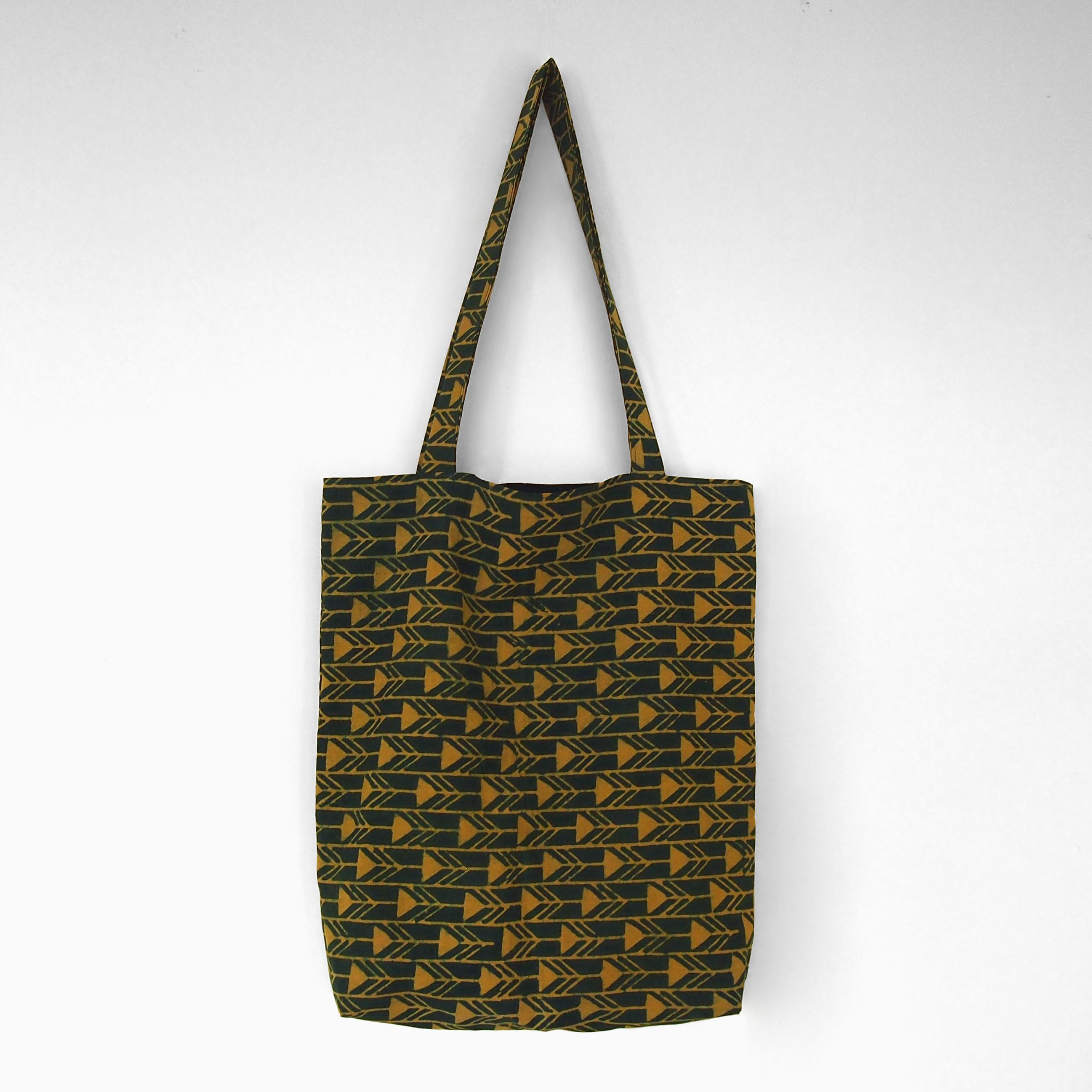 block printed cotton tote bag, green, yellow arrow design, natural dye, lined with black cotton, closed