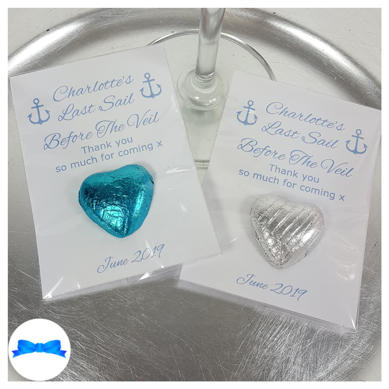 Silver and blue favours with last sail before the veil