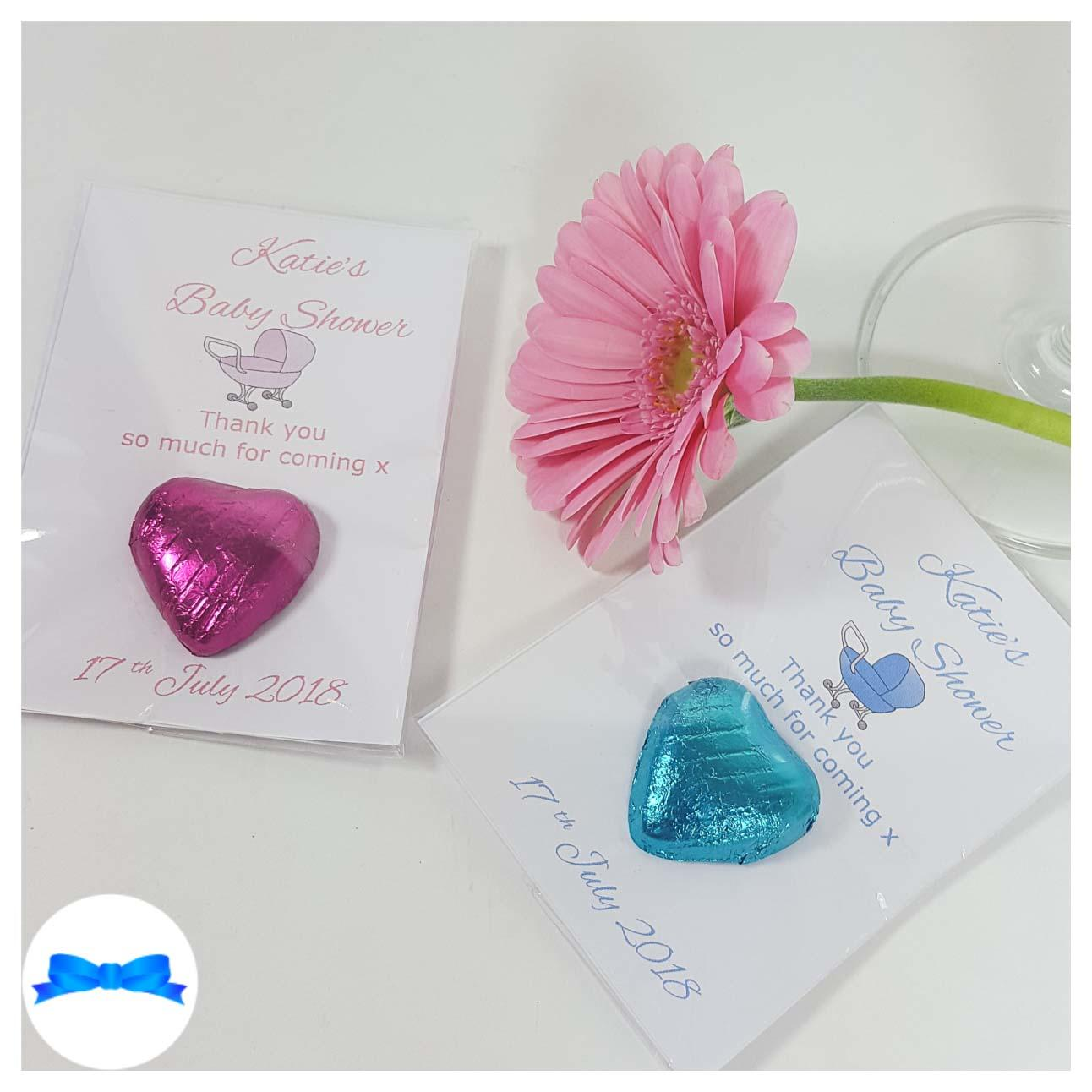 Baby shower chocolate heart favours with pink and blue prams