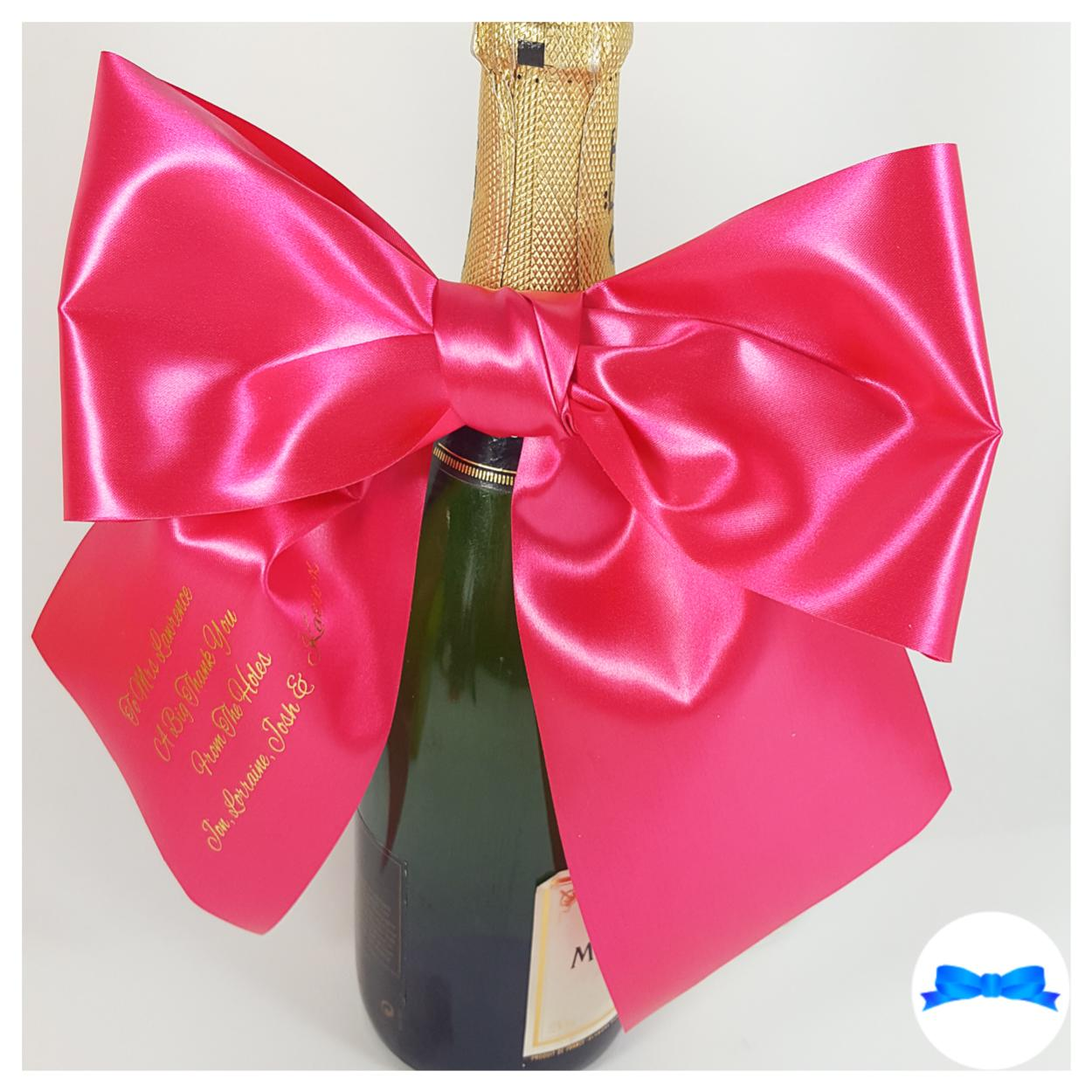Large fuchsia pink and gold print personalised gift bow on bottle