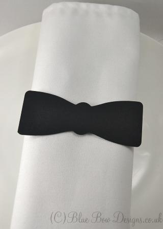 Bow tie shaped plard on white napkin no back stand matt black card