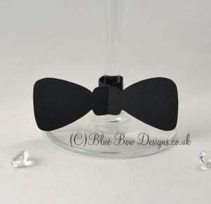 Black card bow tie place card on stem of wine glass