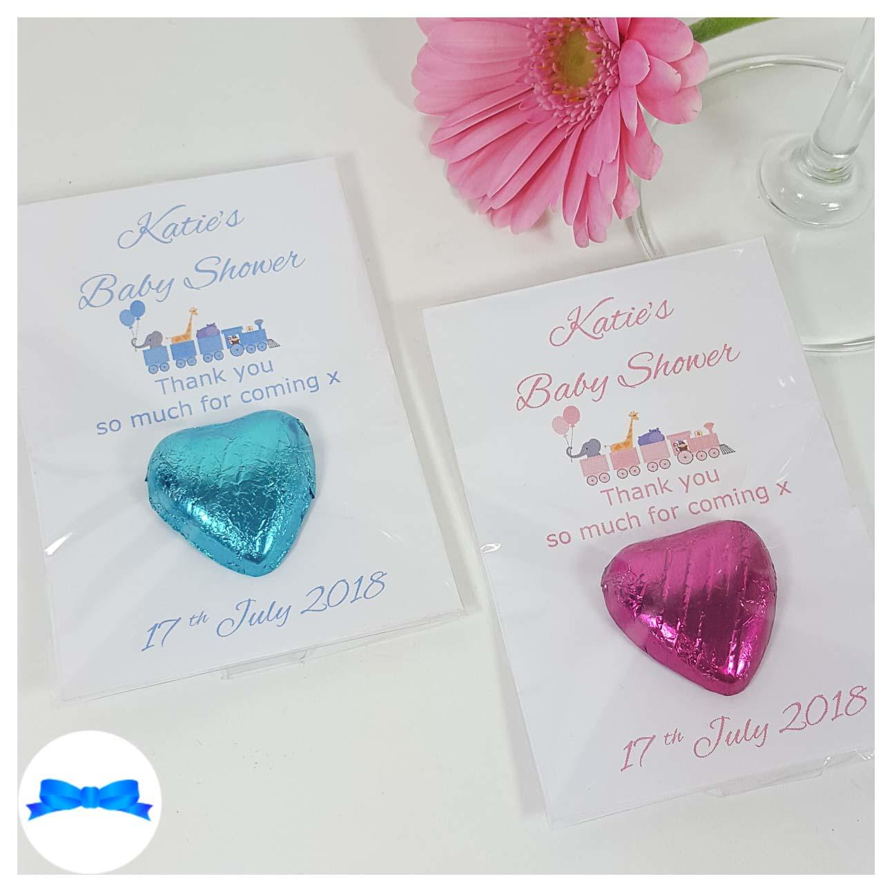 Baby shower chocolate heart favours with pink and blue toy train