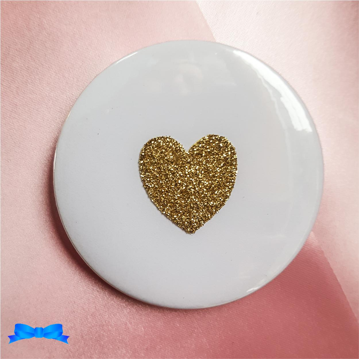 Close up on gold glitter heart badge